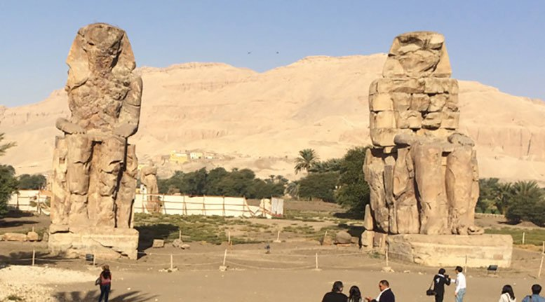 Colossi of Memnon are not far from the Valley of the Kings